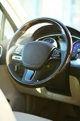 stock photo of speedo  - Interior view of car with beige salon and black dashboard - JPG