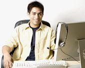 Portrait of Pacific Islander businessman at desk