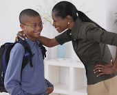 stock photo of pre-adolescents  - African mother hugging son - JPG