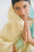 Indian woman in traditional clothing praying