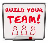 Build Your Team words on a dry erase board telling you to put together a group of employees, workers or members to achieve a common goal or mission