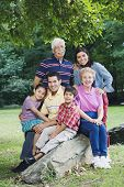 Multi-generational Hispanic family smiling in park