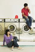 stock photo of laundromat  - Asian couple in Laundromat - JPG