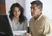 picture of hispanic  - Hispanic couple looking at computer - JPG
