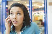 Hispanic teenage girl talking on cell phone