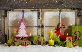 Christmas background or window decoration in red and green colors with candles.