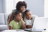 stock photo of pre-adolescent child  - African American mother helping children with homework - JPG