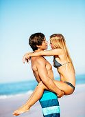 Attractive Good Looking Couple On Beautiful Sunny Beach