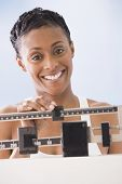 African American woman weighing self