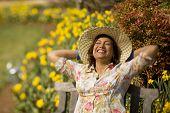 Hispanic woman wearing sun hat
