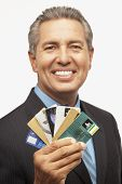 Hispanic businessman holding credit cards