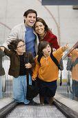 Hispanic family on escalator