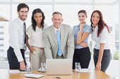 Business people smiling at camera in office
