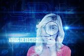 The word virus detected and fair haired woman looking through a magnifying glass against blue technology interface with circuit board