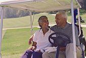 Senior African American couple in golf cart