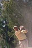 Senior African American man playing golf