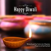 pic of diya  - illustration of burning diya on Diwali Holiday background - JPG