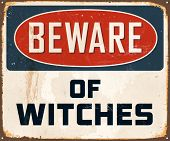 Vintage Metal Sign - Beware of Witches - Vector EPS10. Grunge effects can be easily removed for a brand new, clean design.