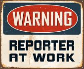 Vintage Metal Sign - Warning Reporter At Work - Vector EPS10. Grunge effects can be easily removed for a cleaner look.