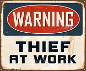Vintage Metal Sign - Warning Thief At Work - Vector EPS10. Grunge effects can be easily removed for a cleaner look.