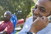 African American man talking on cell phone