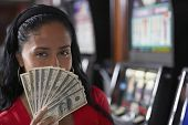 Hispanic woman holding money