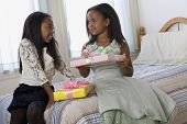 picture of bartering  - African American sisters exchanging gifts - JPG