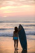 picture of filipina  - Asian girl holding surfboard at beach - JPG