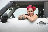 Tattooed Hispanic woman in car
