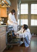 Multi-ethnic couple cooking