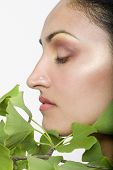 Indian woman's face next to gingko biloba plant