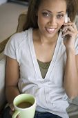 African American woman talking on telephone