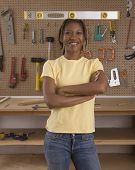 African American woman in woodworking shop