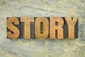 story - a word in vintage letterpress wood type on a green slate rock background
