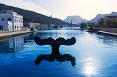 Whale tail sculpture in Cartagena port at Murcia Spain in Mediterranean