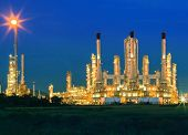 Lighting Of Oil Refinery Palnt Against Dusky Blue Sky Of Oil Refinery Plant In Heavy Petrochemical I