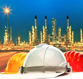 Safety Helmet Against Beautiful Lighting Of Oil Refinery Plant In Petrochemical Industry Estate Use