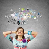 Young woman closing ears with hands and icons flying above
