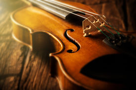 stock photo of mozart  - violin in vintage style on wood background - JPG