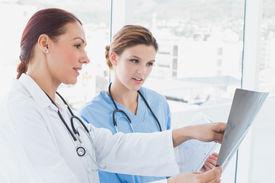 foto of x-files  - Doctors looking at an x - JPG