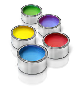 picture of green-blue  - Tin cans with color paints red blue green yellow lilac - JPG