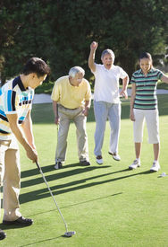 pic of foursome  - Asian man playing golf - JPG