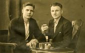 BERLIN, GERMANY, CIRCA 1930's: Vintage photo of two men smoking and drinking tea