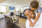 picture of rebuilt  - Playful African American Father and Mixed Race Son in Living Room of House - JPG