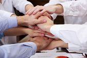 United hands of business team on workspace background