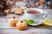 Cup of tea with muffins and ginger