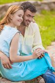 Young Caucasian Happy And Smiling Lovers Together Embraced. Using Pda Pocket Assistant