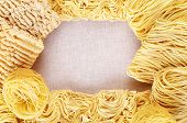 Different dry instant noodles on flax background