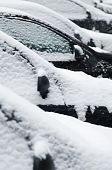 Snow covered car from side