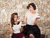 Two Beautiful Girl Friends Having Tea